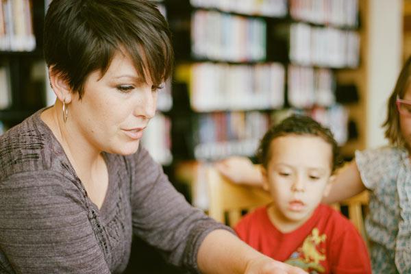 Volunteer reading to children