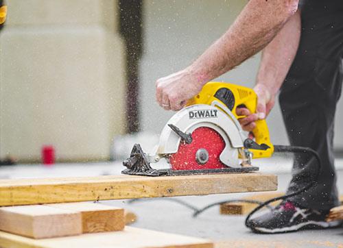 Man using saw